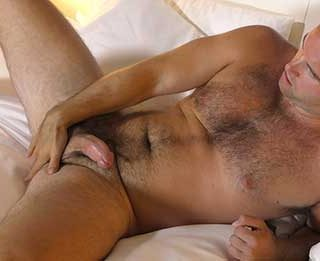 Bobby Hunter describes himself as smart, fun, and, sexy. He's got a great hot guy next door look and doesn't mind showing off his furry tanned body.